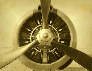 Artificially aged photo of airplane engine and propeller