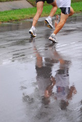 running reflection in wet road