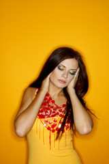 Portrait of Young woman isolated on colour background
