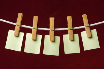 yellow paper attach clothes-peg