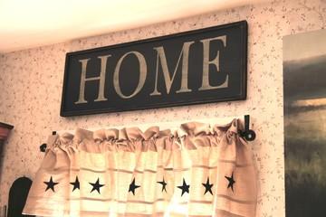 home letter sign displayed on flowered wallpaper 02