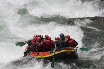 Rafting boat just before the rapids of a whitewater river