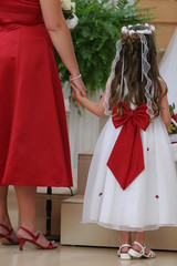 flower girl holding bridesmaid hand red cute