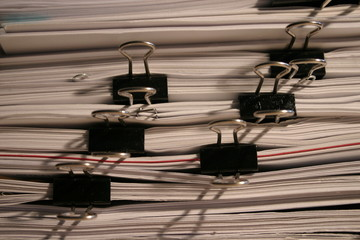 pile of paper sheets with paper-clips
