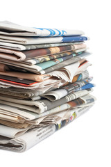 A stack of local newspapers with focus on front. Shallow DOF