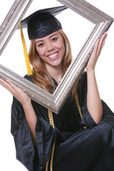 A pretty woman graduating holding a picture frame