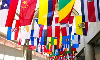 Flags of the world displayed at a convention center