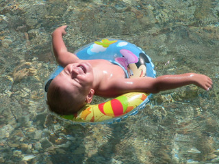 swimming child on a water