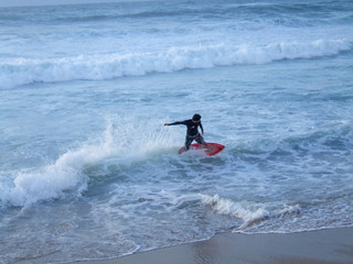 Surfer auf der Welle