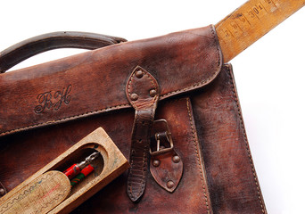 Vintage leather schoolbag, close-up, isolated
