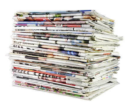 large stack of folded newspapers ready for recycling