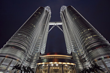 Wall Murals Kuala Lumpur Wide-angle view of the Petronas twin-towers at sunset