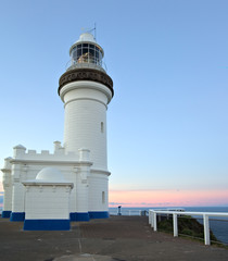 the old lighthouse at byron bay standing tall at sunset