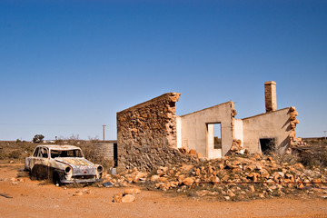 an old car and ruins in the australian outback