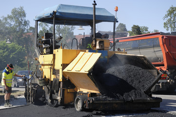 paving machine asphalting the road