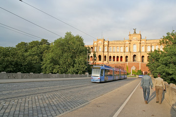 A streetcar (and a couple) on a bridge in Munich