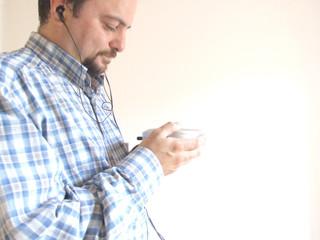 man listening to CDs