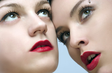 two beaytiful ladies with sensual red lips