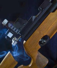 competition rifle with smoke