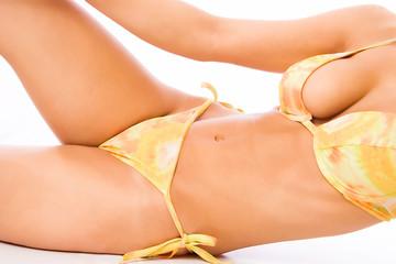woman torso in bikini lying down on white background