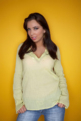 Portrait of Young woman isolated on yellow background