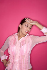 Portrait of Young woman isolated on pink background
