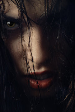 Close-up portrait of woman-witch with wet hairs
