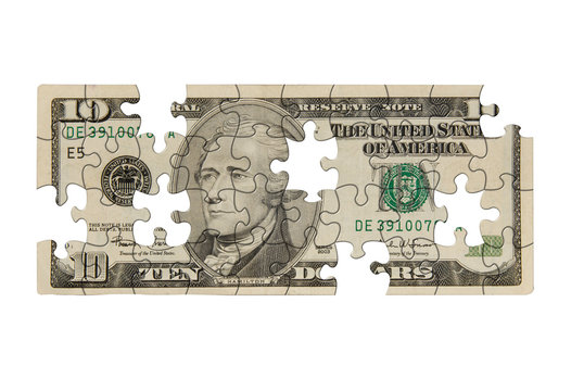 Ten dollar bill with pieces missing