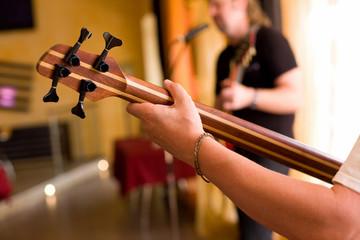 Musician play on bass guitar #2