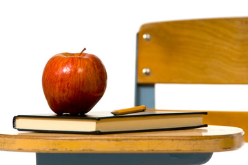 Close view of school desk with aple