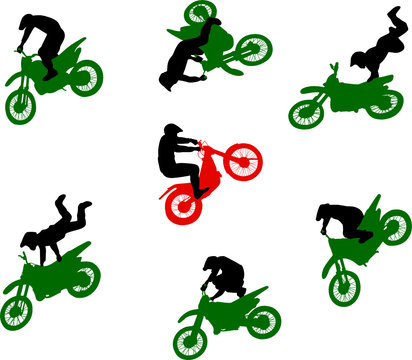 Silhouettes of stuntmen on motorcycles in flight.