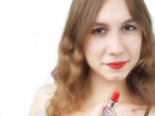 Beautiful girl holding bright red lipstick