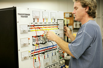 An adult education student learning electronics