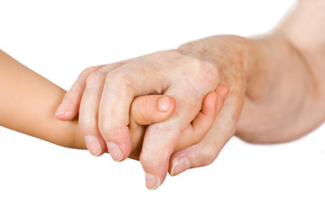 Hands of the girl and the grandmother on an isolated background