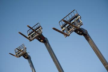 Three Hi-Rise forklift grabs in blue sky