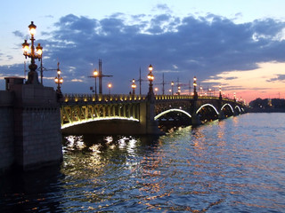 Illuminated bridge on white night in St Petersburg