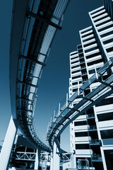 Fotobehang -  Urban architecture. Buildings and monorail