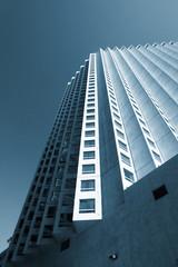 Fotobehang - Skyscraper rising up to the blue sky