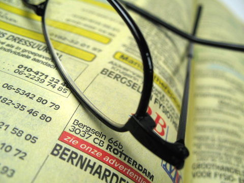 yellow pages and glasses