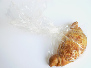 croissant with chese in plastic in plastic bag