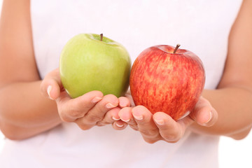 two apples red and green in hands on white