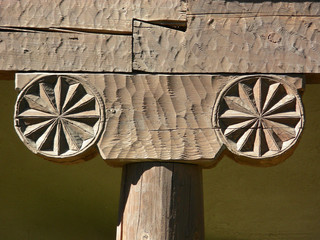 Decorative embellishment on post and beam construction