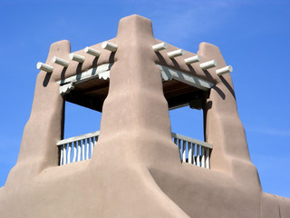 Traditional balcony structure atop an adobe building
