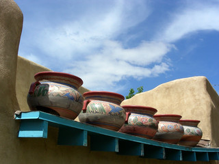 Old clay pots on the roof of an adobe building in New Mexico