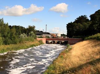 Sluice gate and Bridge over a swollen River