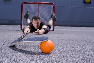 street hockey player in action #3