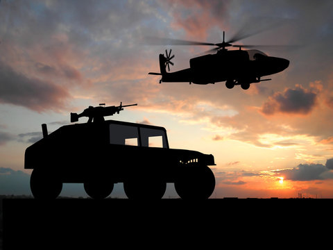 Silhouette of truck over sunset with helicopter.