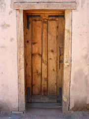 Door to original pioneer cabin built of adobe and wood