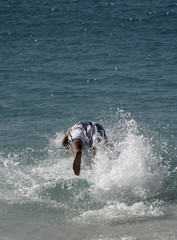 man diving into the ocean
