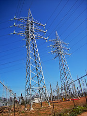 Power line poles from an electrical substation in spain